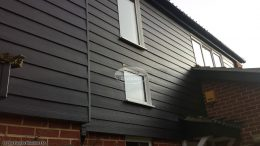 black hardiplank cladding with black ash fascias soffits