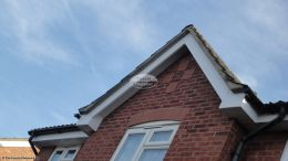 Semi detached full replacement fascia boards installation white tongue grove soffits with black halfround guttering Havant
