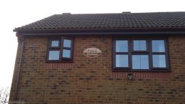 Rosewood soffits and fascias, round brown guttering in Fareham