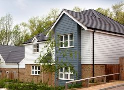 Hardieplank weatherboard cladding on detached house