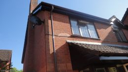 Installation Of New rosewood Upvc Fascias Soffits And Brown Guttering On A Detached House in Waterlooville
