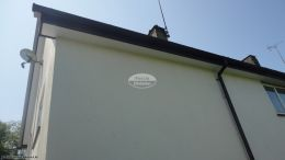 Full replacement of UPVC black ash fascias white soffits and black half round guttering West Meon Petersfield