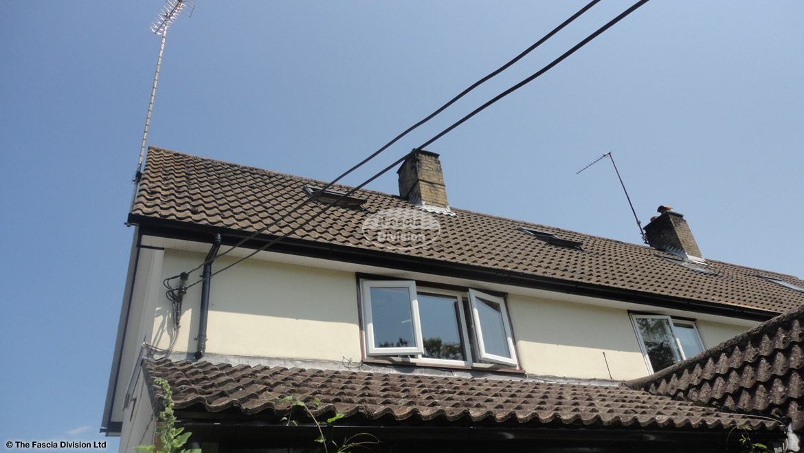 Recent installation of UPVC black ash fascias and soffits in a white tongue and groove effect West Meon Petersfield