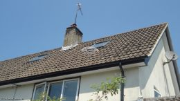 Replacing fascias soffits and guttering using black ash UPVC fascia with white tongue and groove effect black half round guttering gable neighbor houses West Meon Petersfield