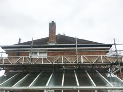 Fascia, soffit and guttering installation using scaffolding