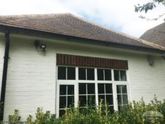White fascias and soffits and black guttering
